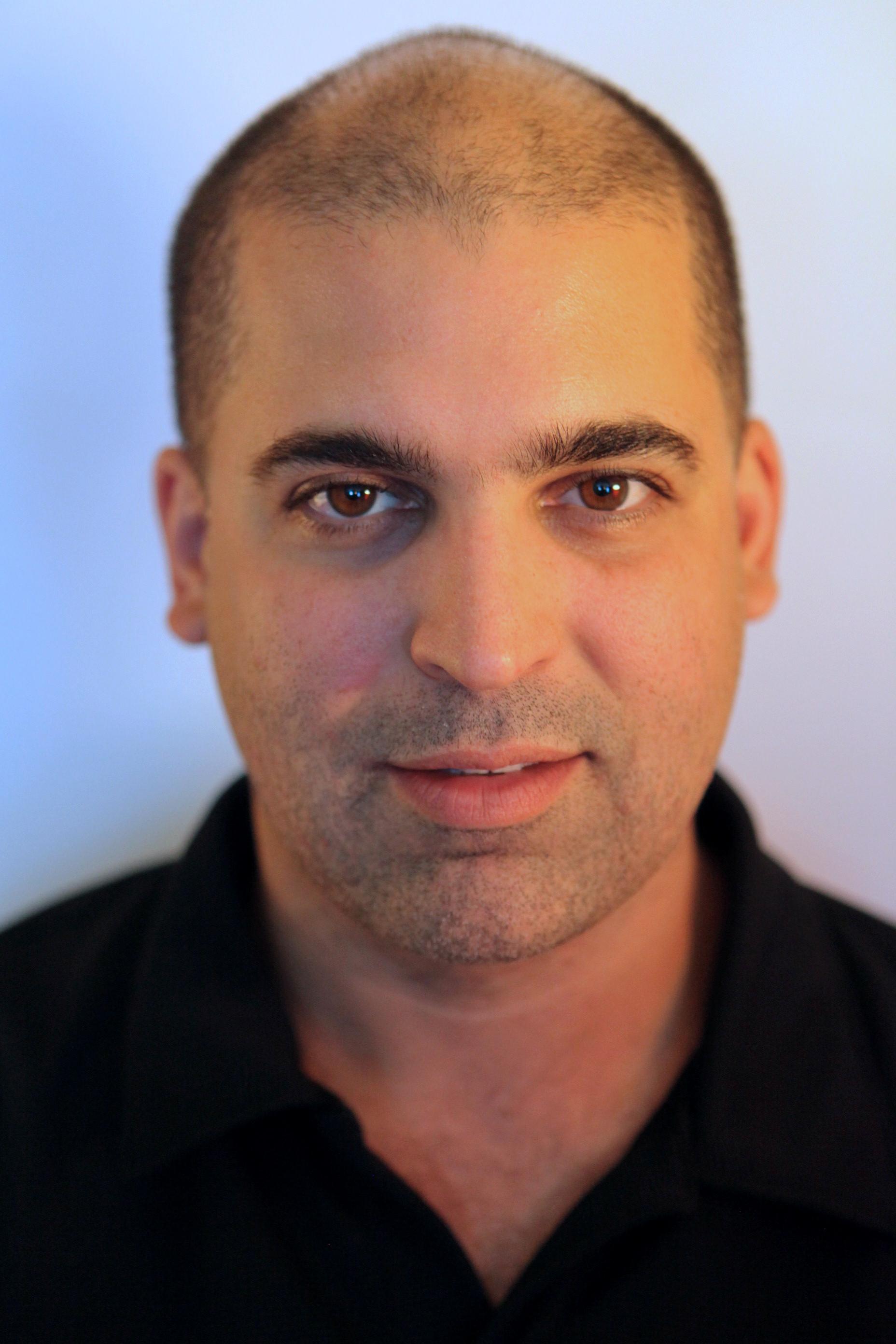 Headshot of Guillermo Rodríguez-Romaguera