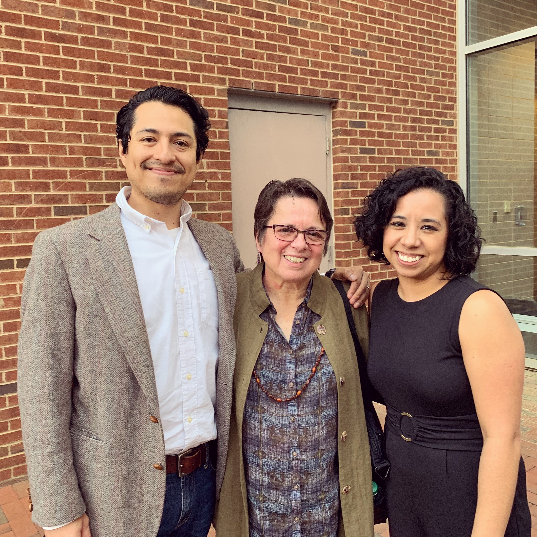 Cherríe Moraga poses for a photo outside the Stone Center with Latina/o Studies Program graduate assistants Geovani Ramírez and María Durán.
