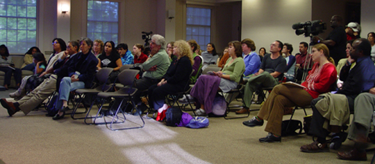 Faculty and students sit in an event space for the Latina/o Studies Program's Inauguration