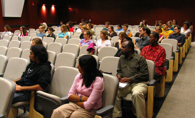 The audience at Loida Maritza Pérez' talk sits attentively in a large auditorium.