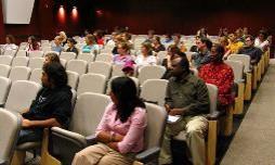The audience at Loida Martiza Pérez's talk sits attentatively in Fox Auditorium, Carrington Hall